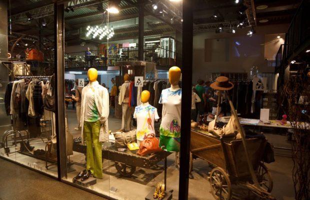 12512164 - showcase backlit. exhibition of designer clothes.