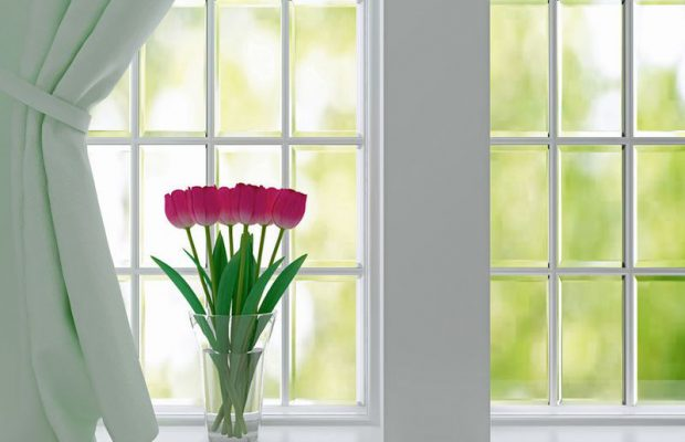 28252670 - bouquet of pink flowers (tulips) on a windowsill.