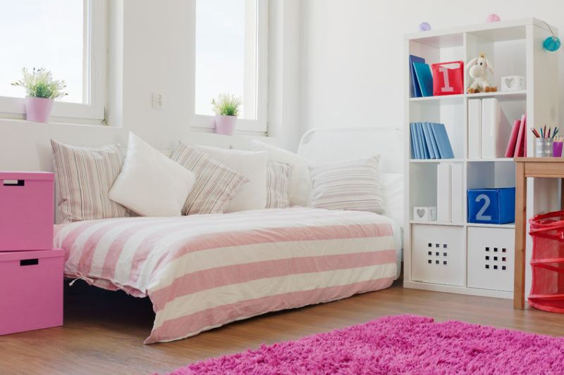 39950899 - a lot of cushions on the bed in girl's room