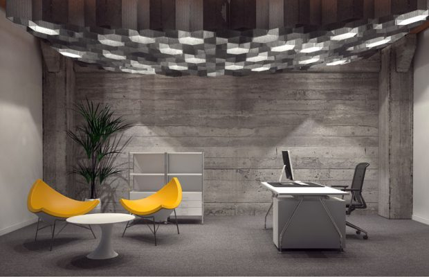 40942952 - modern corporate office interior for a ceo with grey brick walls, contemporary yellow triangular seating and a desk with computer lit from above by a group of hexagonal down lights. 3d rendering.