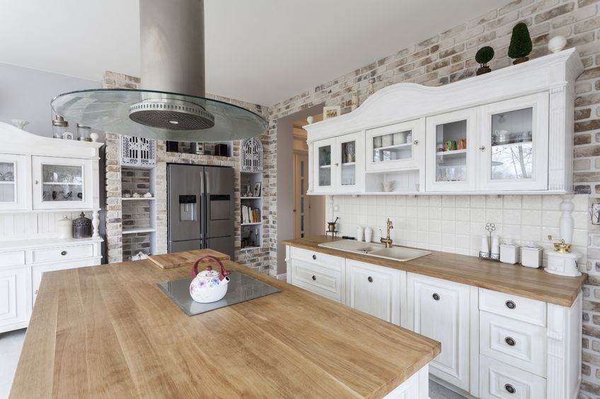 18918222 - tuscany - white kitchen shelves and silver refrigerator