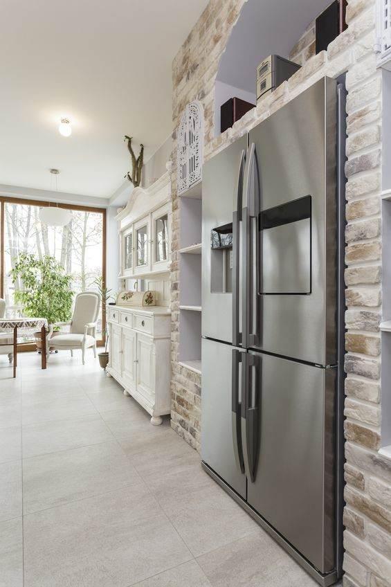18918225 - tuscany - silver refrigerator in kitchen interior