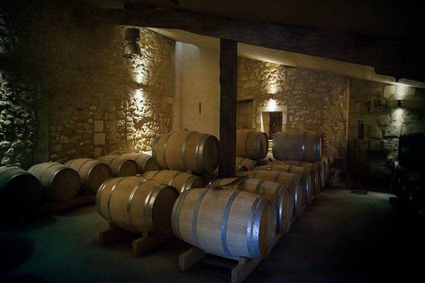 15064122 - row of wine barrels in old winery