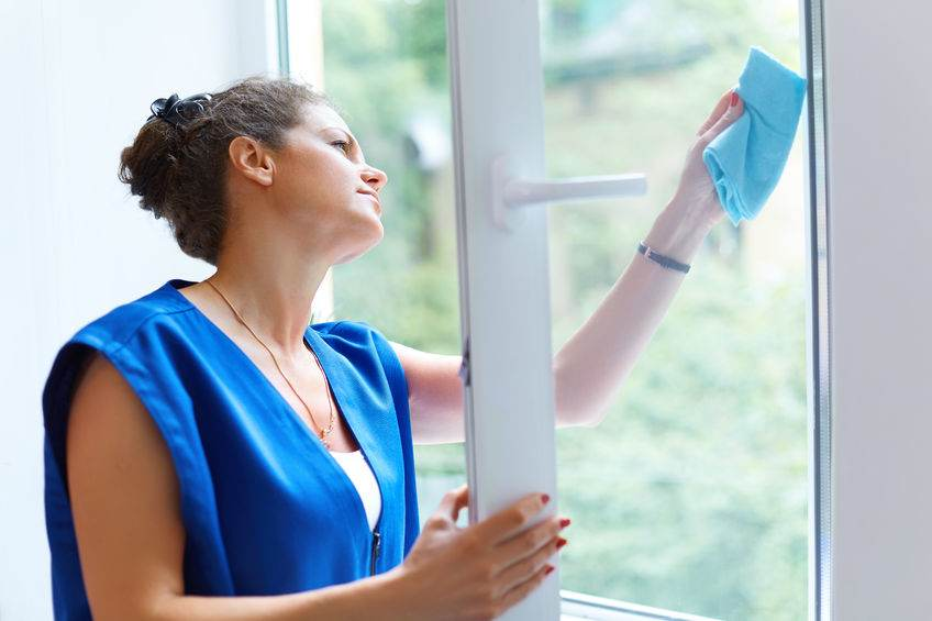 45743823 - attractive woman washing the window. cleaning company worker working