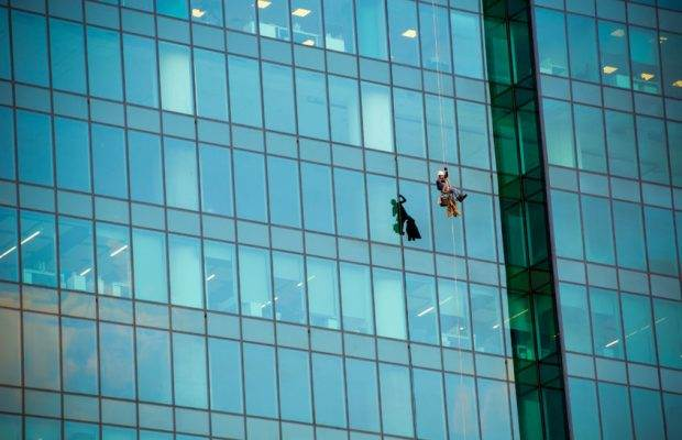 59470285 - moscow- april 25, 2016:window cleaners at work on the fortieth floor height